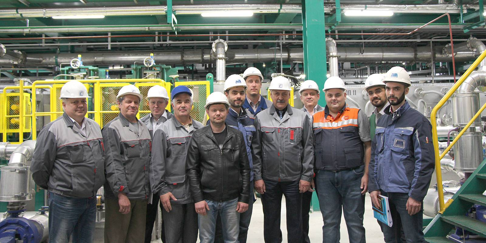 Souvenir picture from LMZ plant. <br> From left to right:  Terentyev S.N. (Lead Power Engineer), Solomin A.V. (Head of Capital Construction), Kolyvanov I.V. (Deputy Chief Engineer), Filippov S.V. (Deputy Chief Engineer on New Tech), Peretyagin O.V. (Power Engineer), Shamrey V.A. (General Director MetPromStroy), Ogorodov I.A. (Project Manager for LMZ), Deineko A.D. (General Director), Chistyakov I.P. (Technical Director MC LMC), Sabbadini M. (Site & Commissioning Manager), Pankin I.P. (Director of Legal Affairs), Shamrey I.A. (Project Manager for MetPromStroy).