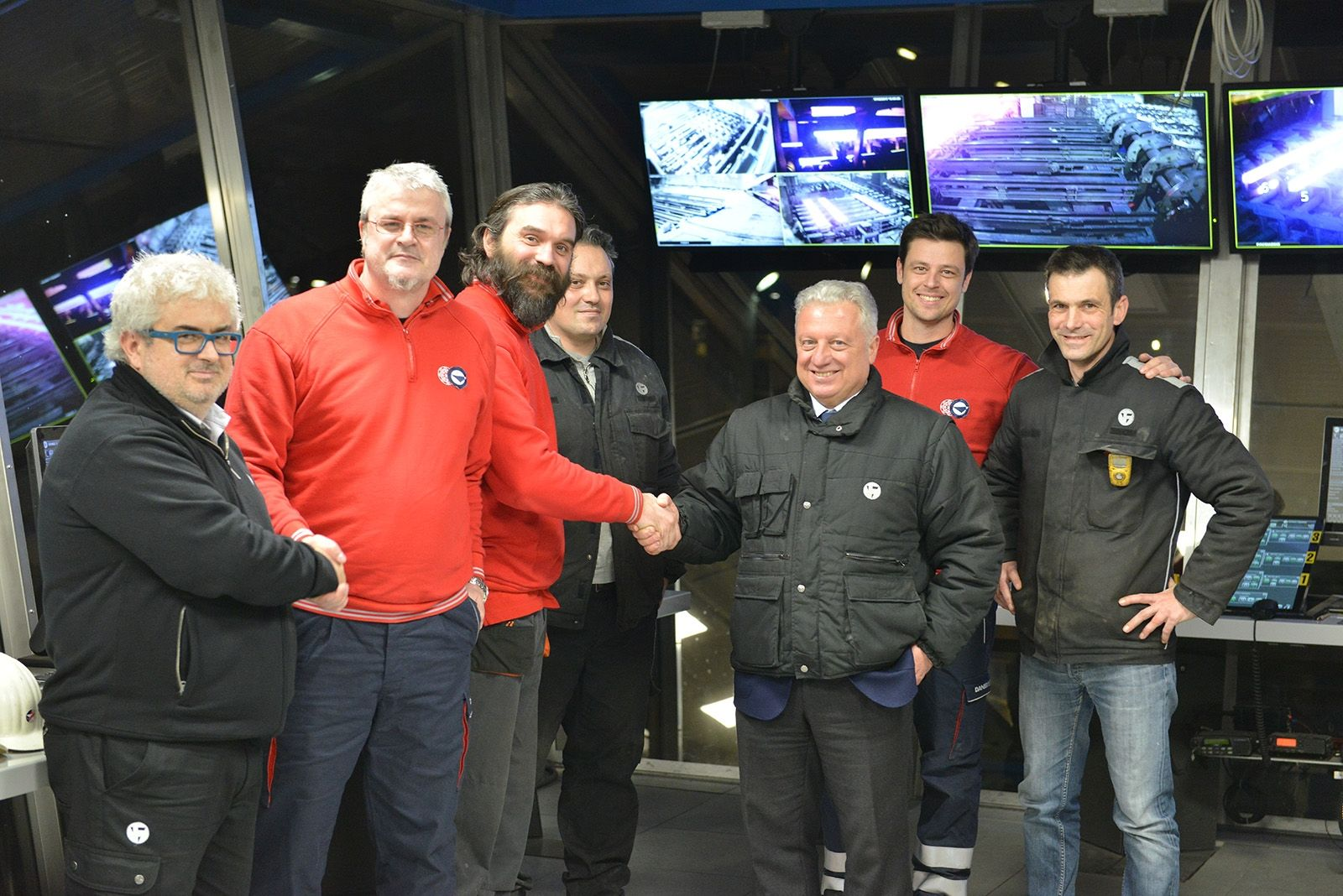 Congratulation between teams after the successful restart of the upgraded billet caster